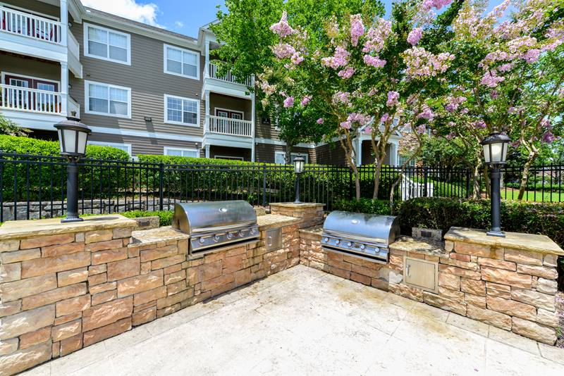grill area at Duck Pond at Johns Creek Apartments