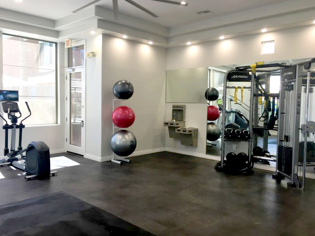 fitness center at Clarendon Park Apartments