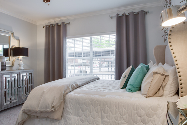 bedroom at The Palmer at Las Colinas Apartments