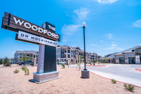 signage at The Woodford on Mockingbird apartments