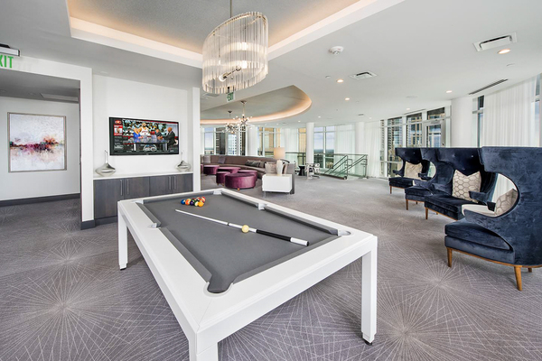 game room at Ascent Uptown Apartments