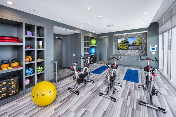 fitness center at Ascent Uptown Apartments