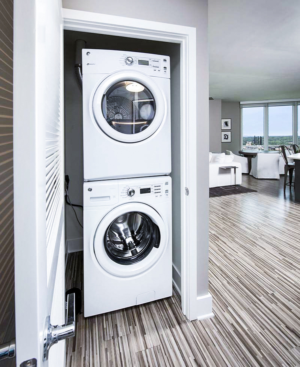 laundry room at Ascent Uptown Apartments