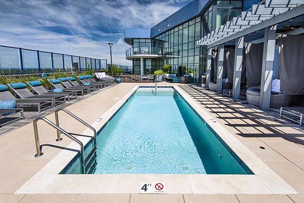rooftop heated saltwater pool at Ascent Uptown Apartments