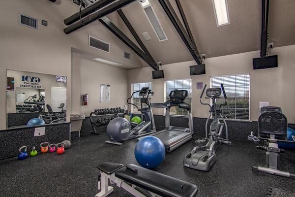 fitness center at The Trails at Wolf Pen Apartments