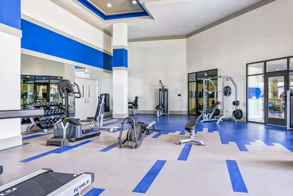 fitness center at One Riverwalk Apartments