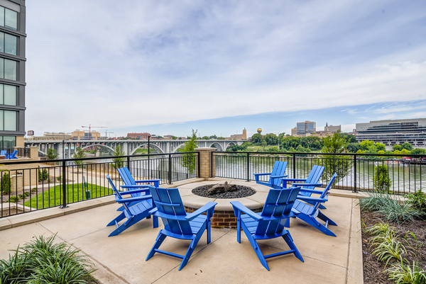 fire pit at One Riverwalk Apartments