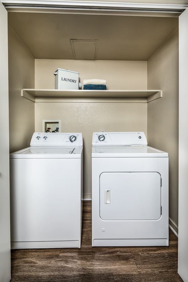 laundry room at Trio Apartments