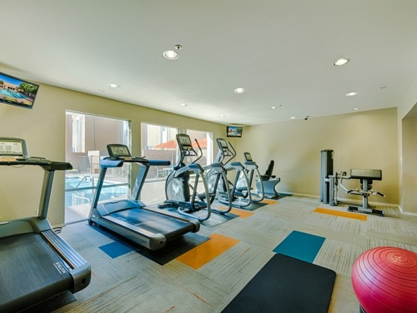 fitness center at The Cortesian Apartments