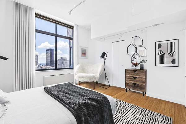 bedroom at 800 Sixth Apartments