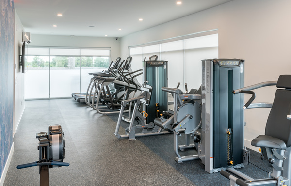 fitness center at Alexan Diagonal Crossing Apartments