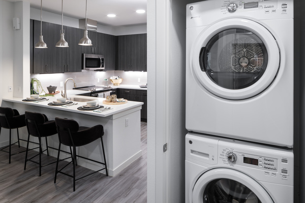 laundry room at Alexan Diagonal Crossing Apartments