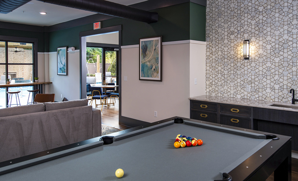 game room at One Riverside Apartments