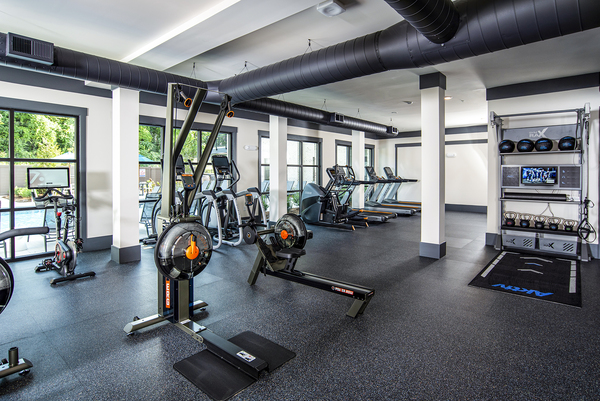fitness center at One Riverside Apartments