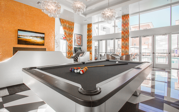 game room at Elysian at the District Apartments