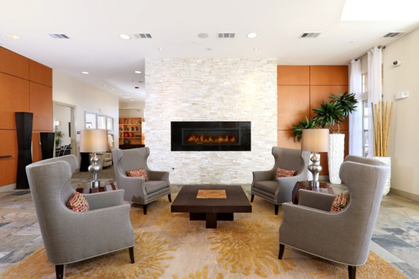 clubhouse fireplace lounge area at Arvada Station Apartments