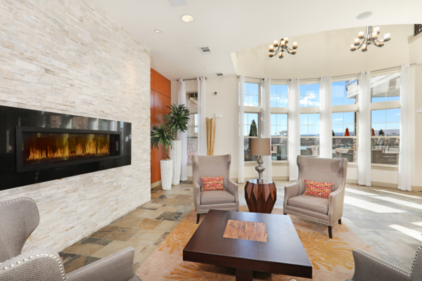 clubhouse fireplace lounge area at at Arvada Station Apartments