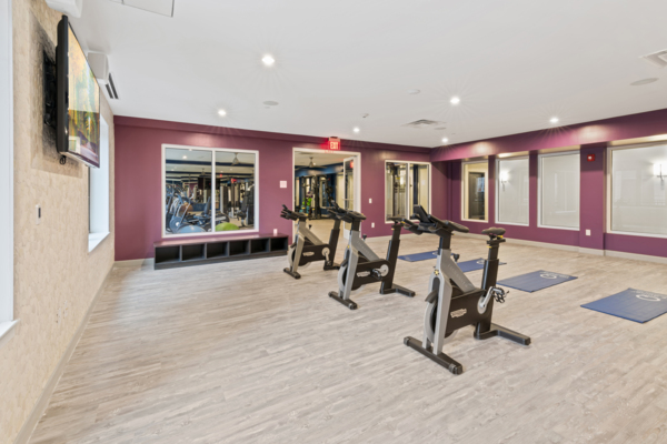 Fitness room at The Quincy Apartments
