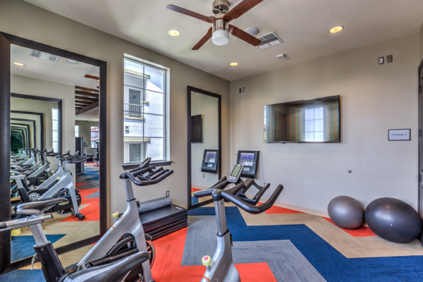 fitness center at Miro Apartments