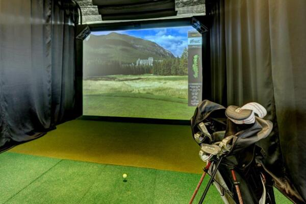 virtual golf at Parq at Iliff Apartments