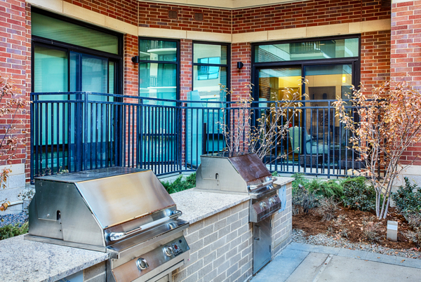 grill area at Raleigh at Sloans Lake Apartments