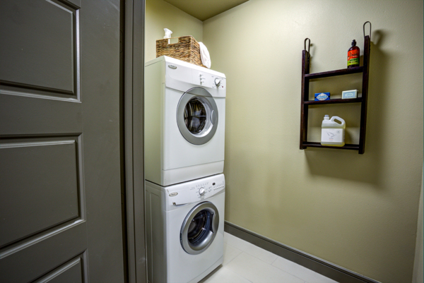 laundry room at The Kenzie at the Domain Apartments