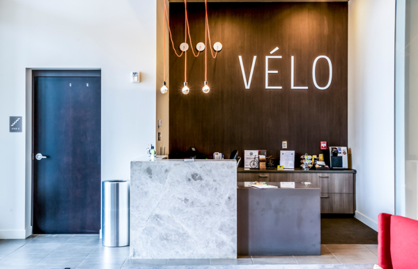 front desk lobby at Velo Apartments