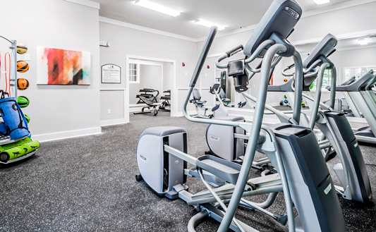 fitness center at HUE97 Apartments