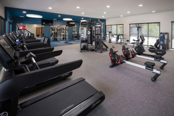 fitness center at The Well Apartments