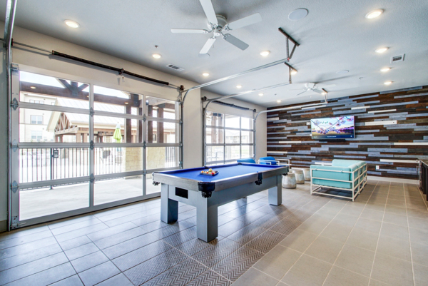 game room at Enclave Falcon Pointe Apartments