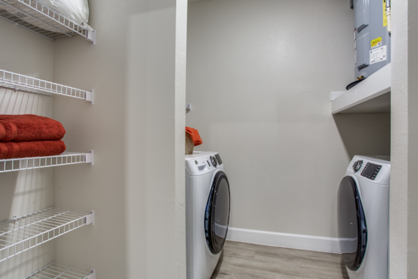 laundry room at Quest Apartments