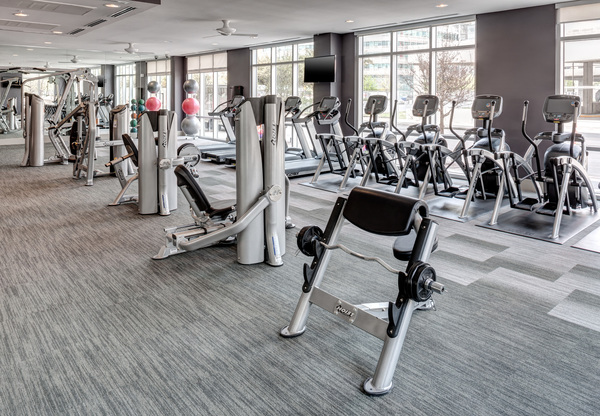 fitness center at Arpeggio Victory Park Apartments