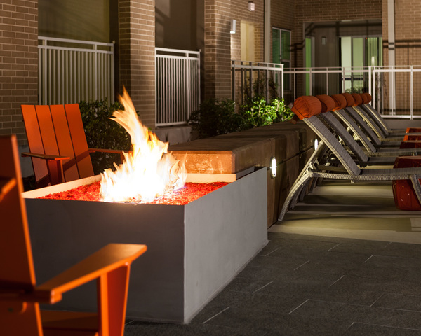 fire pit at Arpeggio Victory Park Apartments