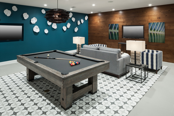 game room at Alexan Henderson Apartments