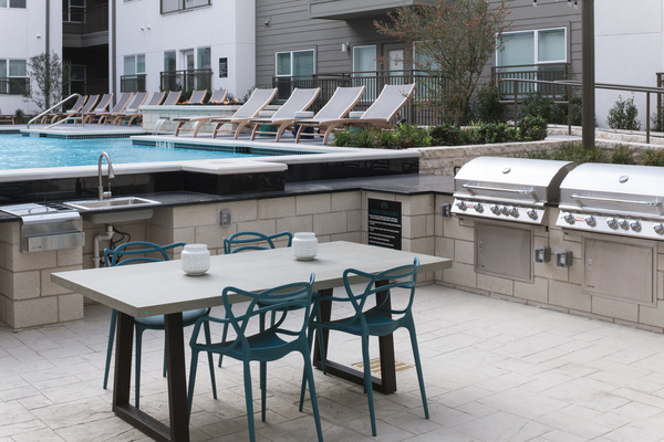 grill area at Alexan Henderson Apartments