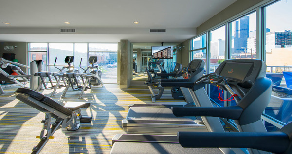 fitness center at Point 21 Apartments