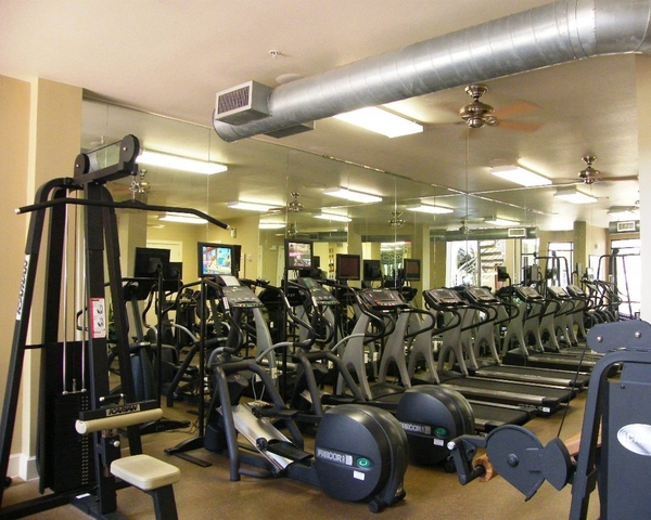 fitness center at The Circle at Hermann Park - Esplanade Apartments