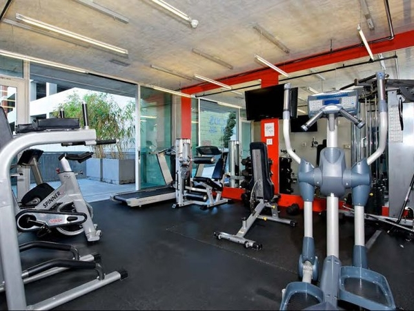fitness center at Sixth&G Apartments