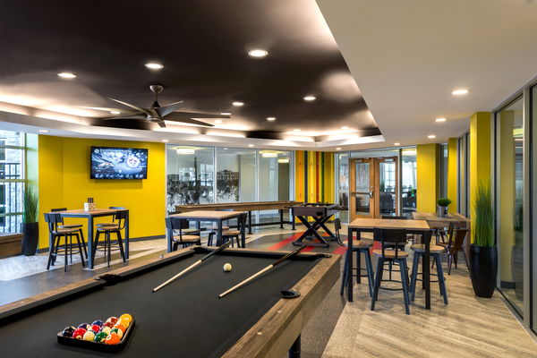 game room at Aventine at Fort Totten, A Greystar Avana Community