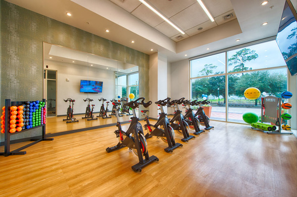 fitness center at One Hermann Place Apartments