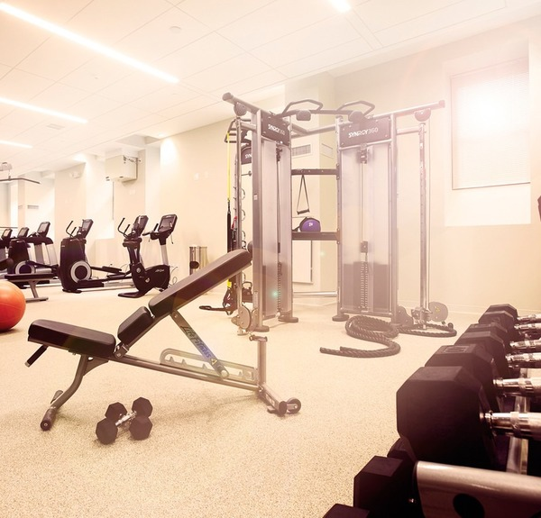 fitness center at James and Harrison Court Apartments