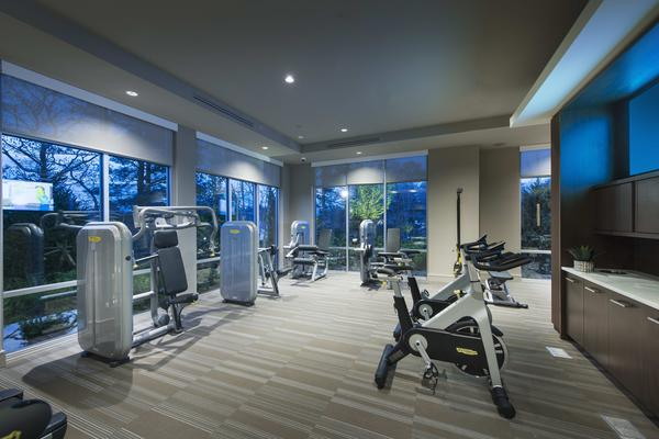 fitness center at Marq at the Pinehills Apartments