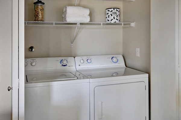 laundry room at The Hills of Corona Apartments