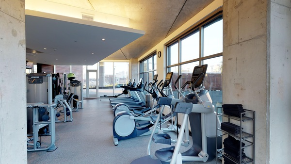 fitness center at Bridge on Race Apartments
