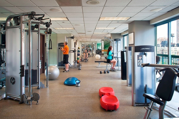 fitness center at One Superior Place Apartments
