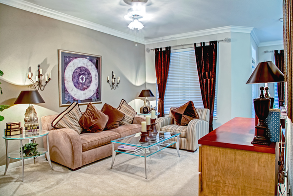 living room at Plaza at Westchase Apartments