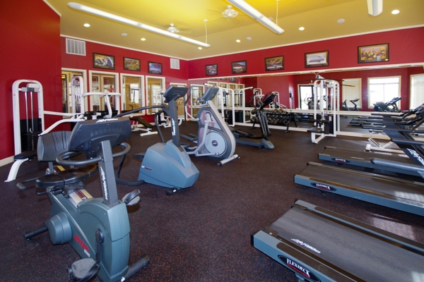 fitness center at Champions at Norwood Apartments