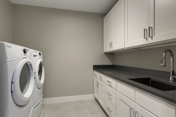 laundry room at The Lakes Residences Apartments