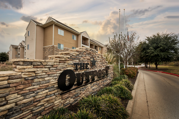 signage at Outpost at Waco Apartments