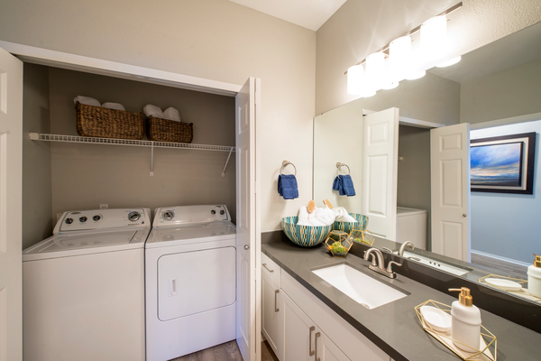 laundry room at Avana One Six Four Apartments